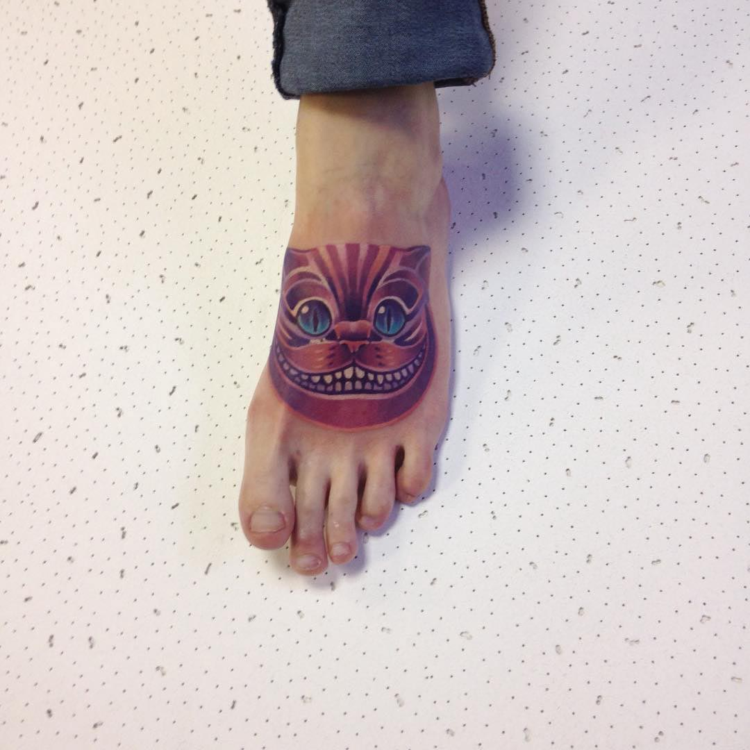 Cheshire cat tattoo on foot