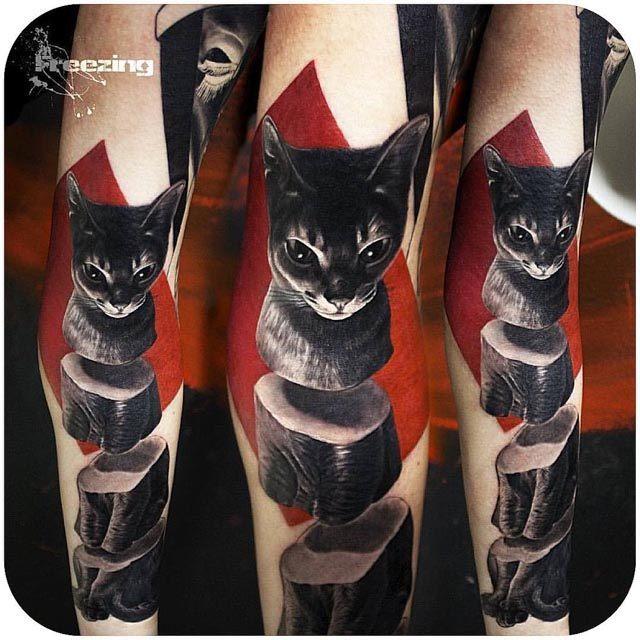 black cat tattoo on arm sliced