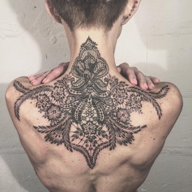 baroque pattern back tattoo