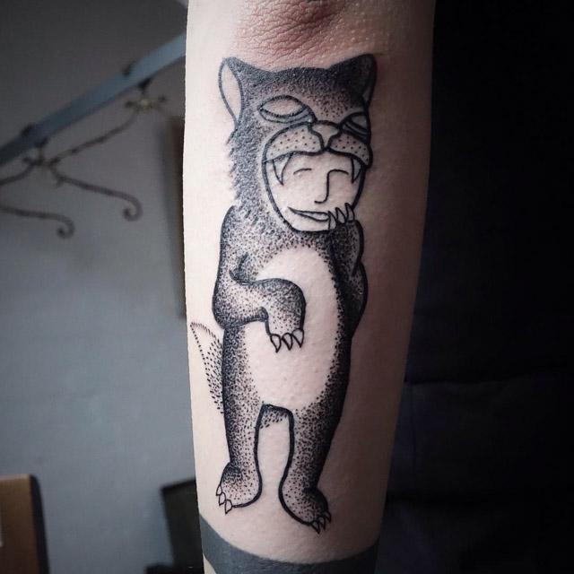 dotwork tattoo on arm