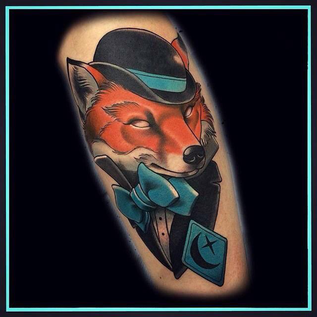 fox tattoo in hat