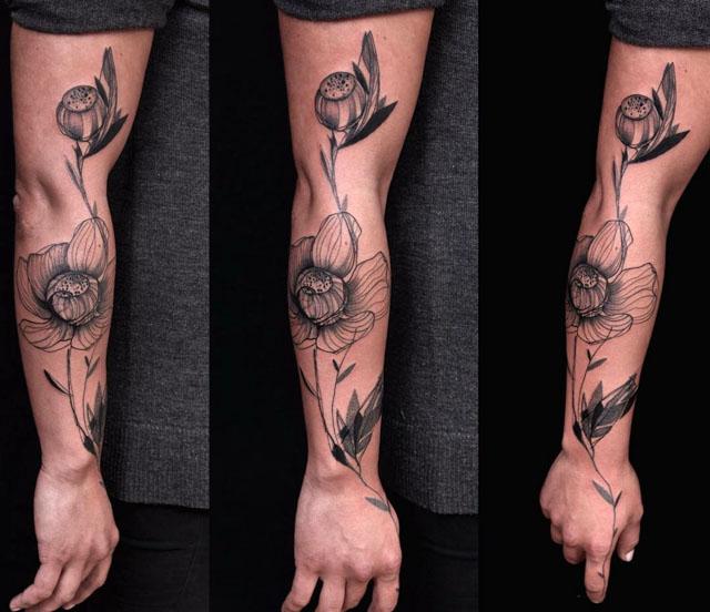 arm tattoo poppy