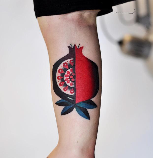 quater cut tattoo pomegranate