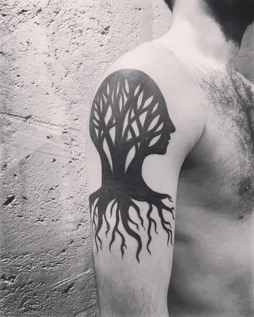 blackwork tree tattoo on shoulder