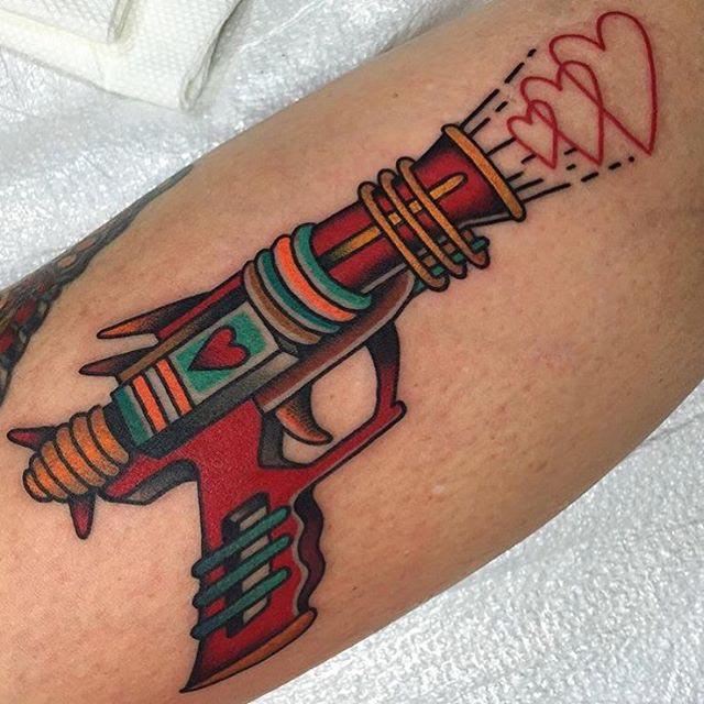 Love gun tattoo neo-traditional