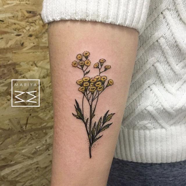 arm tansies flowers tattoo