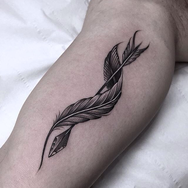 arrow and twisted feather tattoo