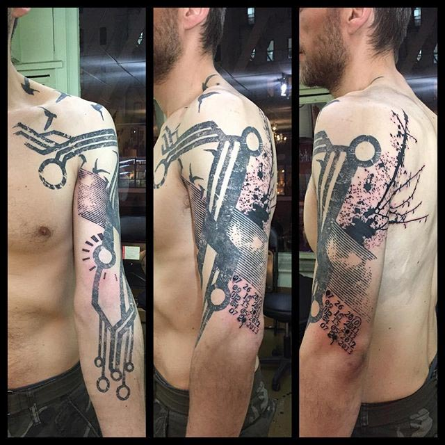 Chip tattoo on shoulder