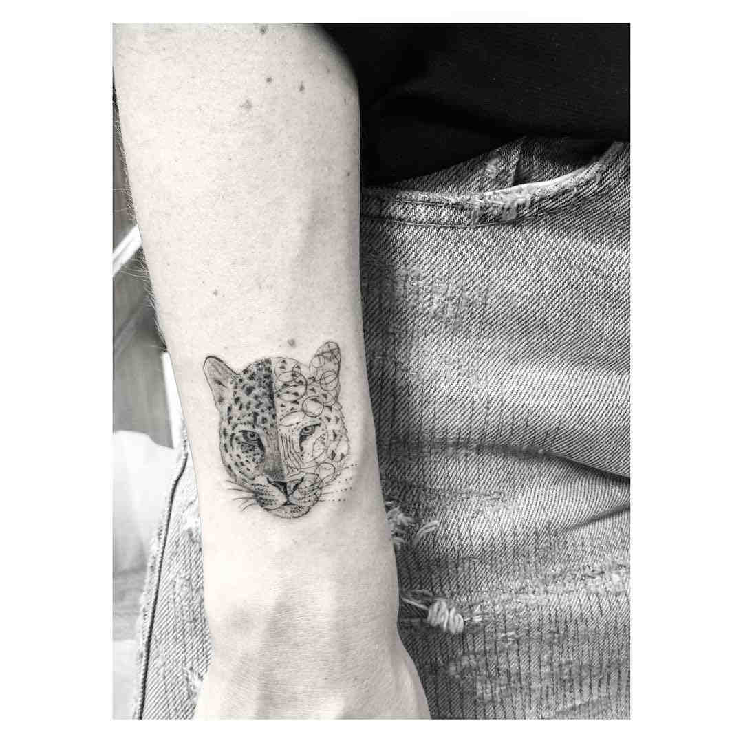 cougar face tattoo on arm