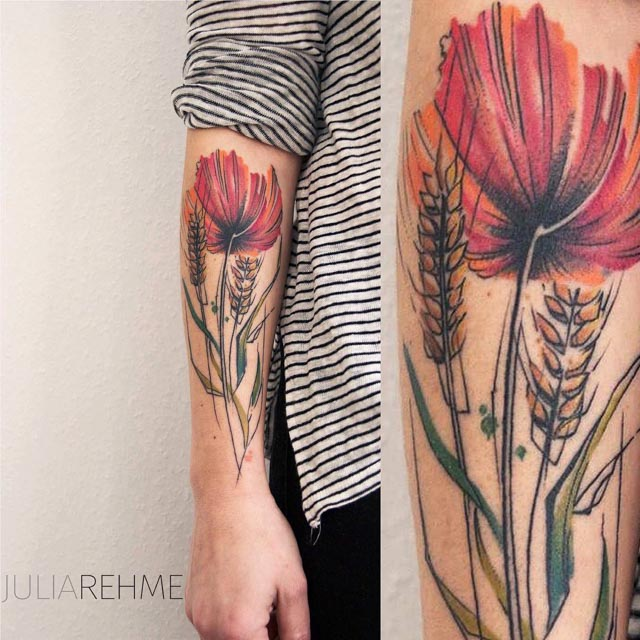 watercolor tattoo poppy on forearm