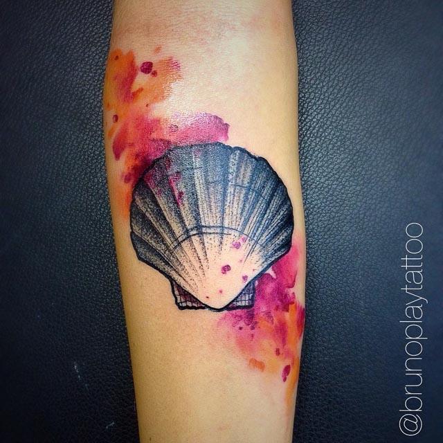 arm tattoo sea shell