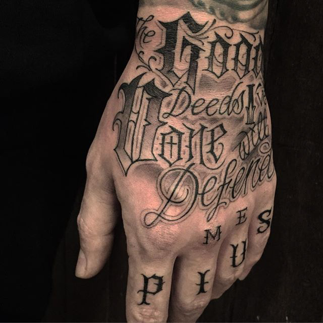 Chicano lettering tattoo on hand