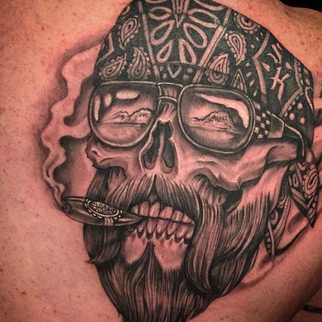 cigar smoking skull tattoo