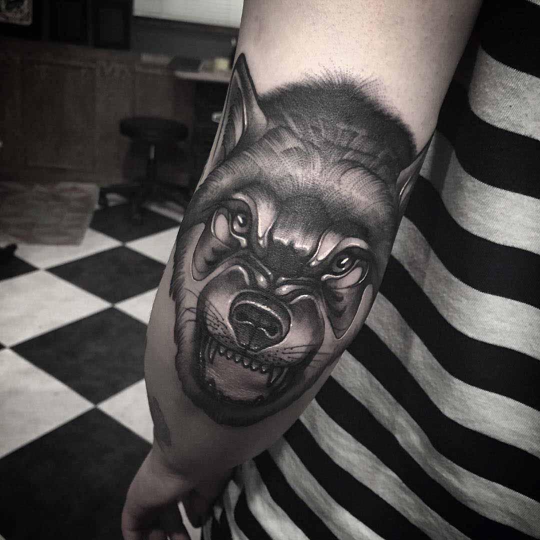 elbow tattoo wolf