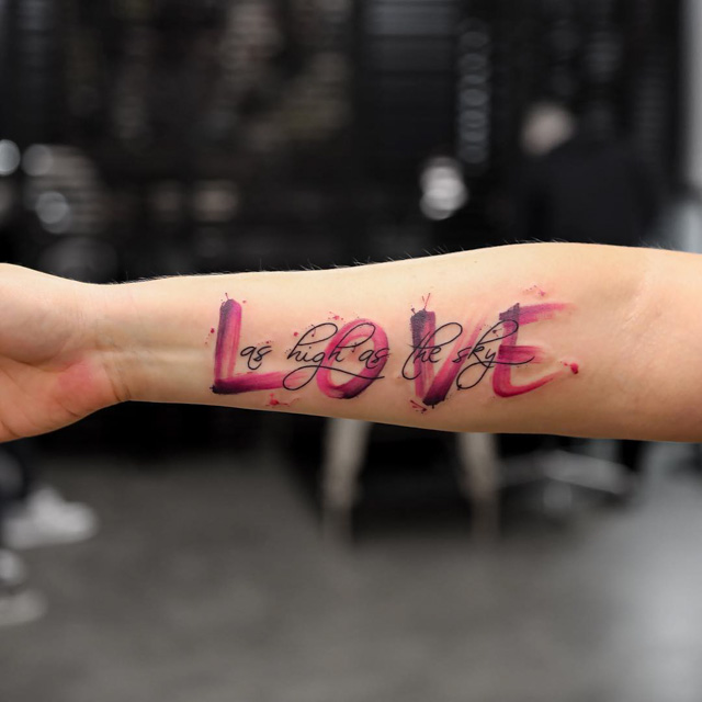pink love tattoo word