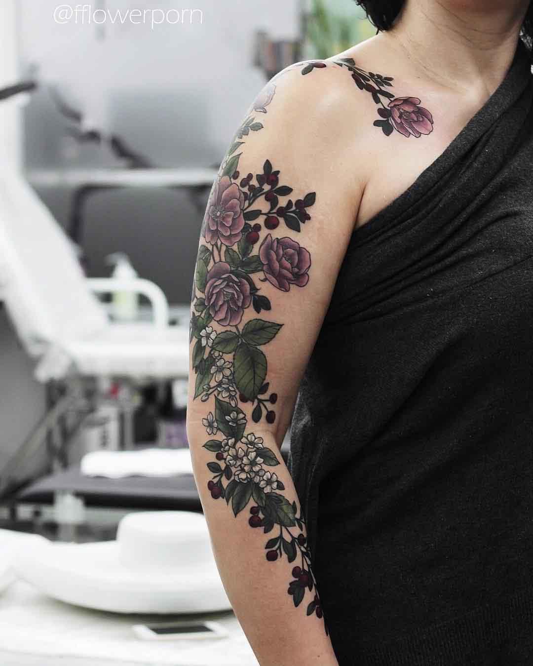 a lot of flowers tattoo sleeve