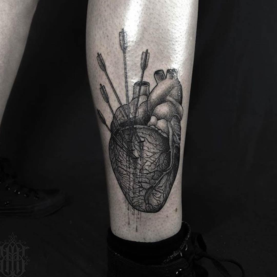 arrows in heart tattoo