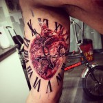 Heart Clock Tattoo on Bicep