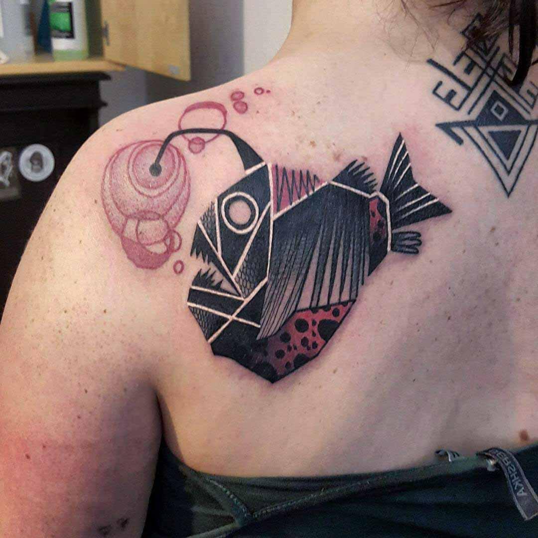 shoulder blade sea devil tattoo