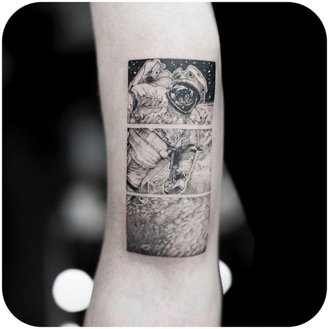 astronaut tattoo on arm