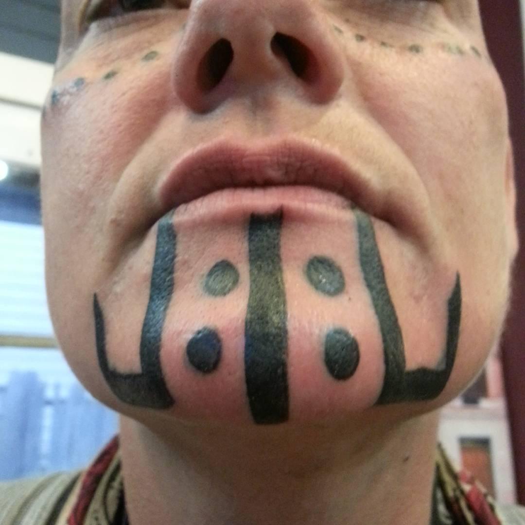 Black Tribal Chin Tattoo by brandontearztattoo