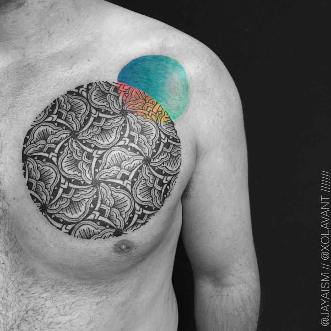 circle pattern tattoo on chest