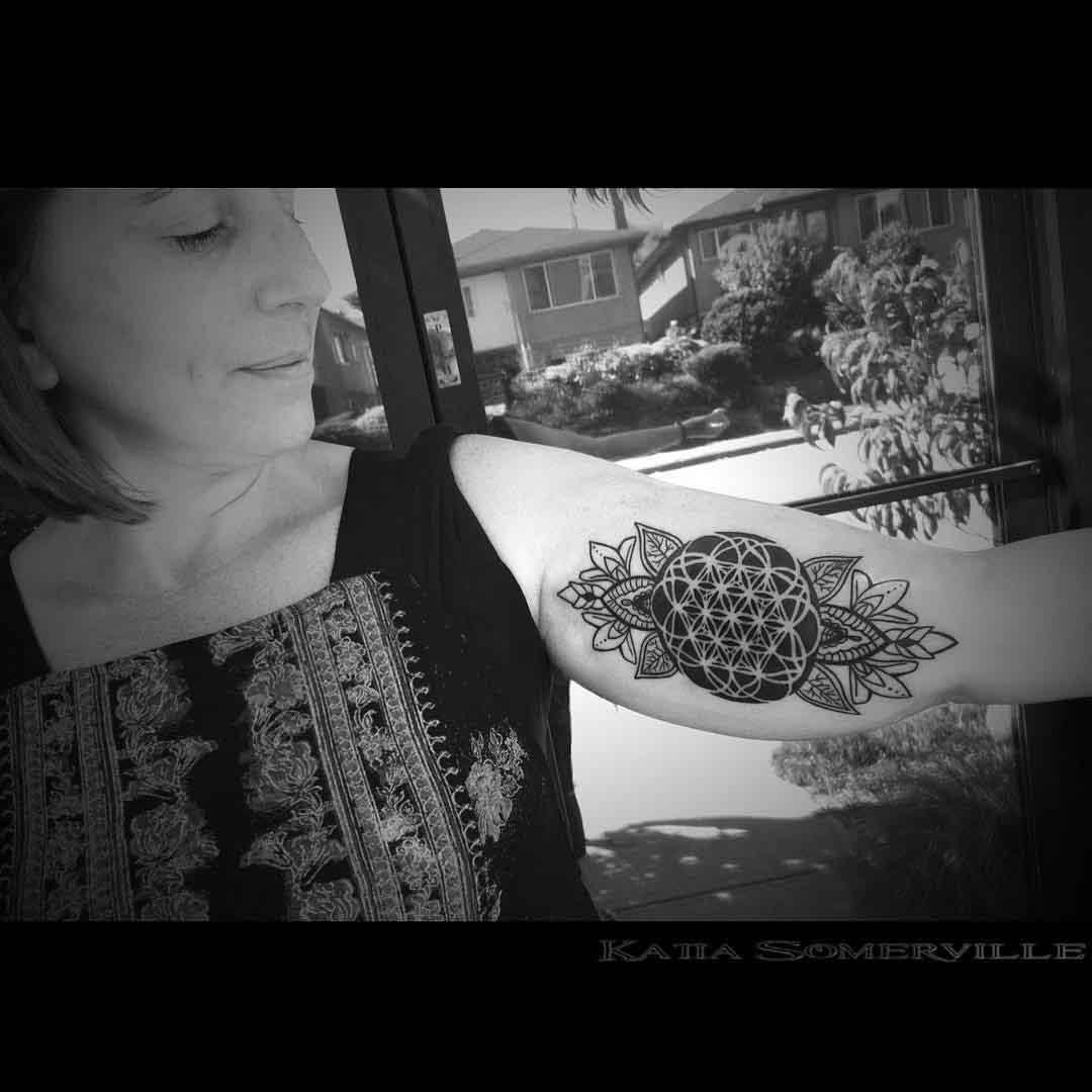 girl inner bicep tattoo dotwork