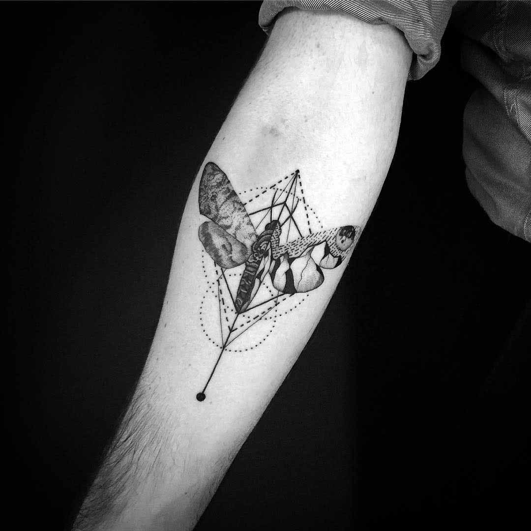 cool moth tattoo on arm
