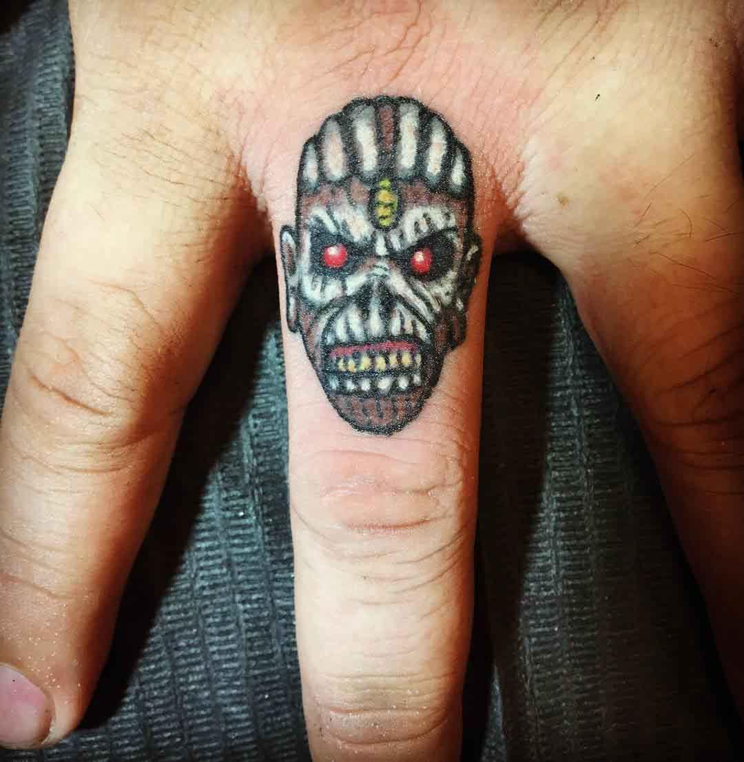 zombie head finger tattoo