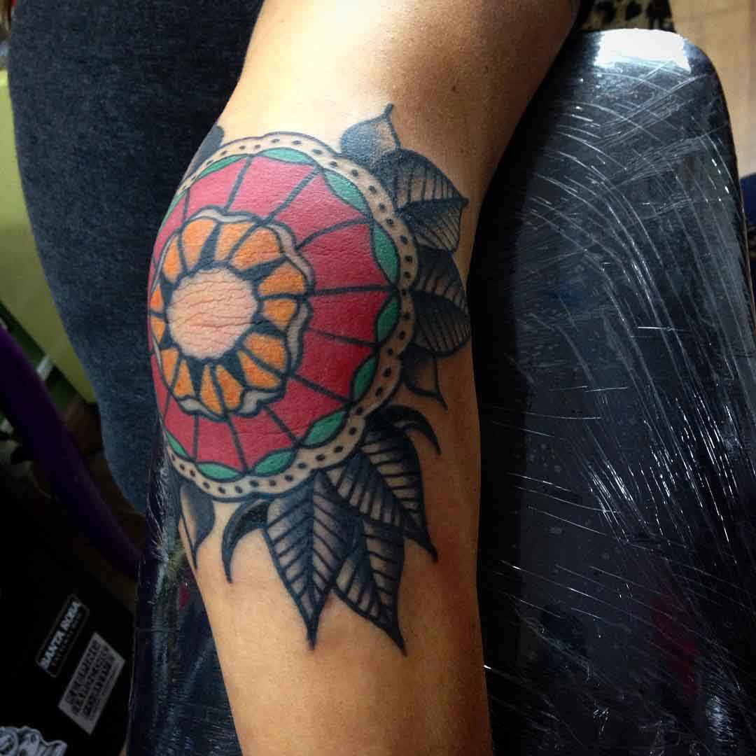 Elbow tattoo traditional