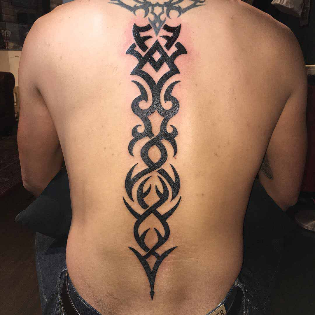 Tribal Spine Tattoo by huatcai168