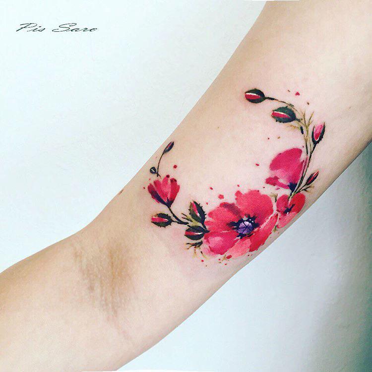 poppies bright tattoo on bicep