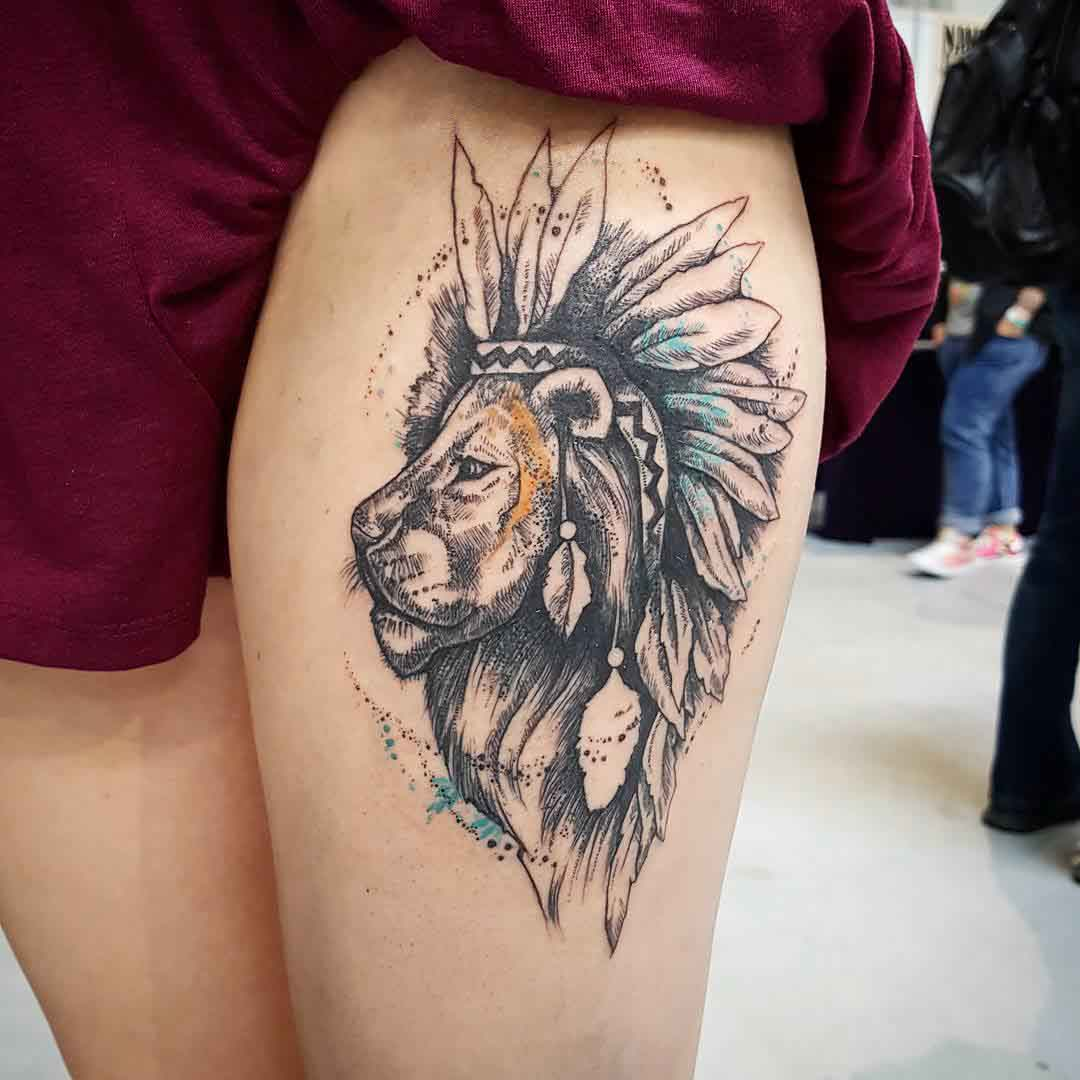 thigh tattoo lion with feathers