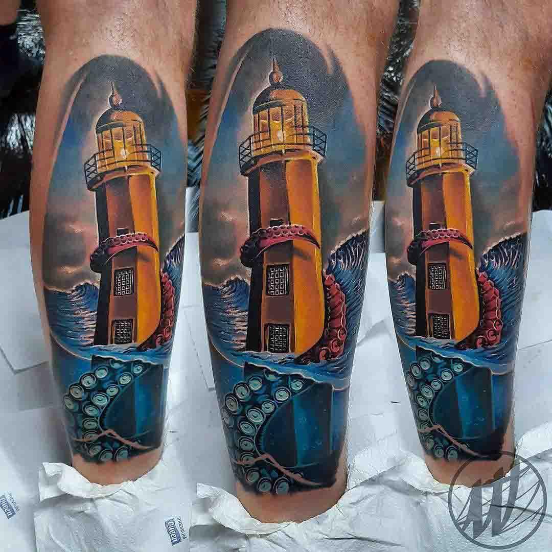 Lighthouse tattoo on calf