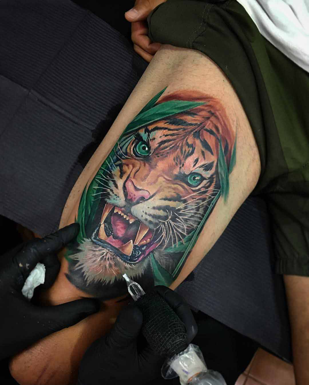 angry tiger tattoo on thigh