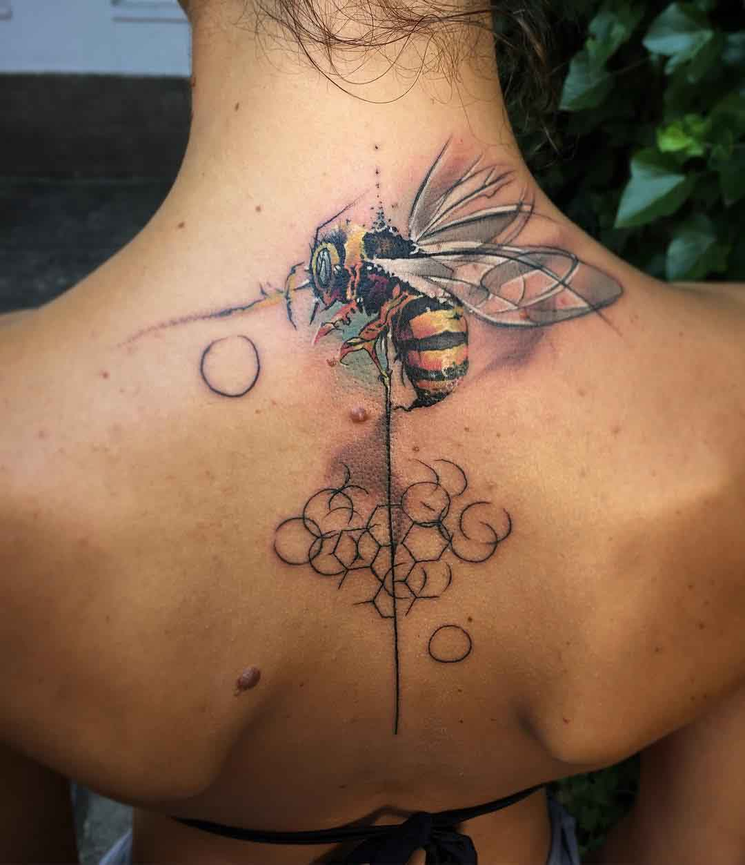 wasp tattoo back neck