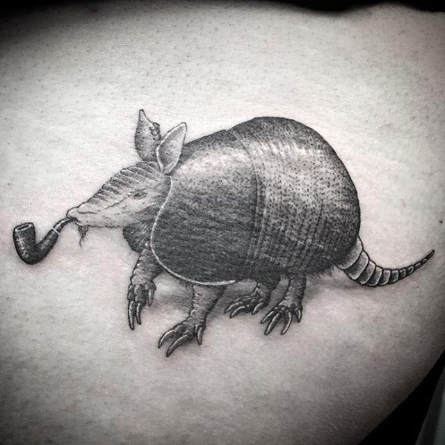 graphic armadilo tattoo