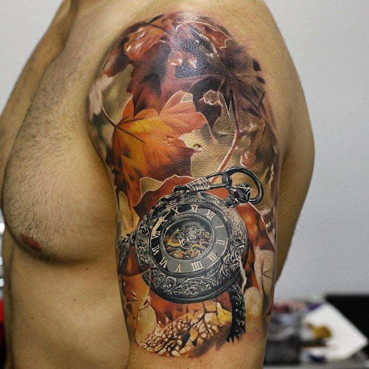 old clock and yellow leaves tattoo on shoulder