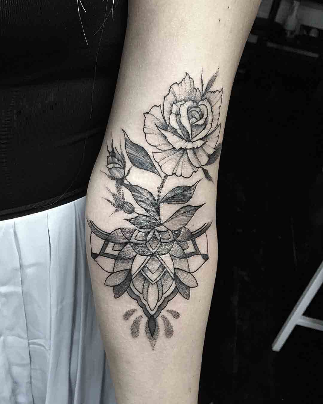rose inner elbow tattoo