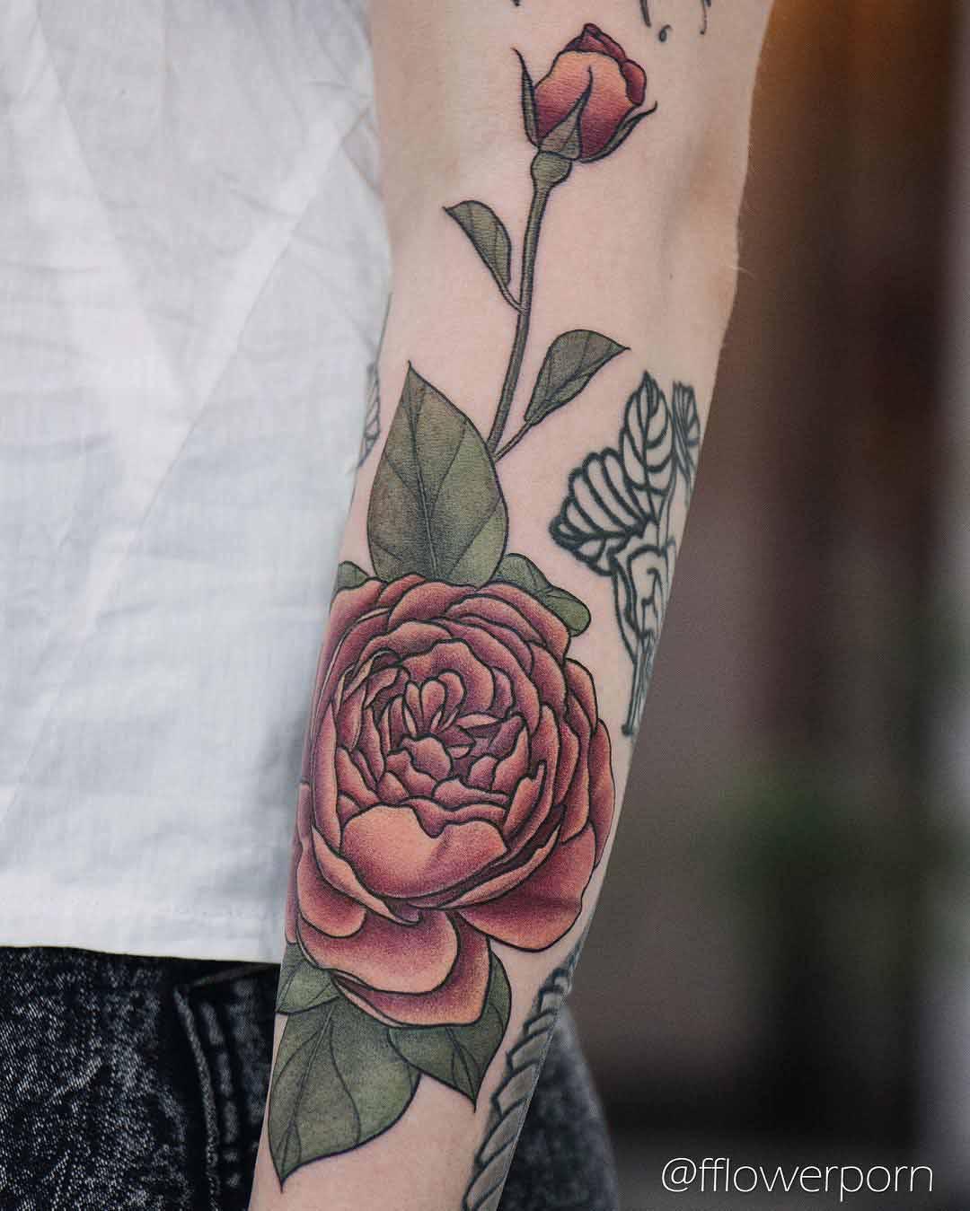 roses tattoo on arm