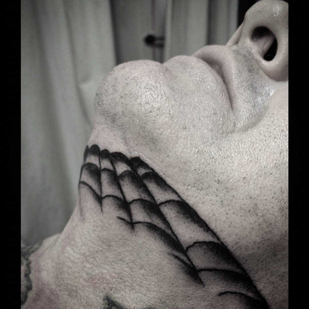 Spider Web Tattoo on Chin by valoniatattoos