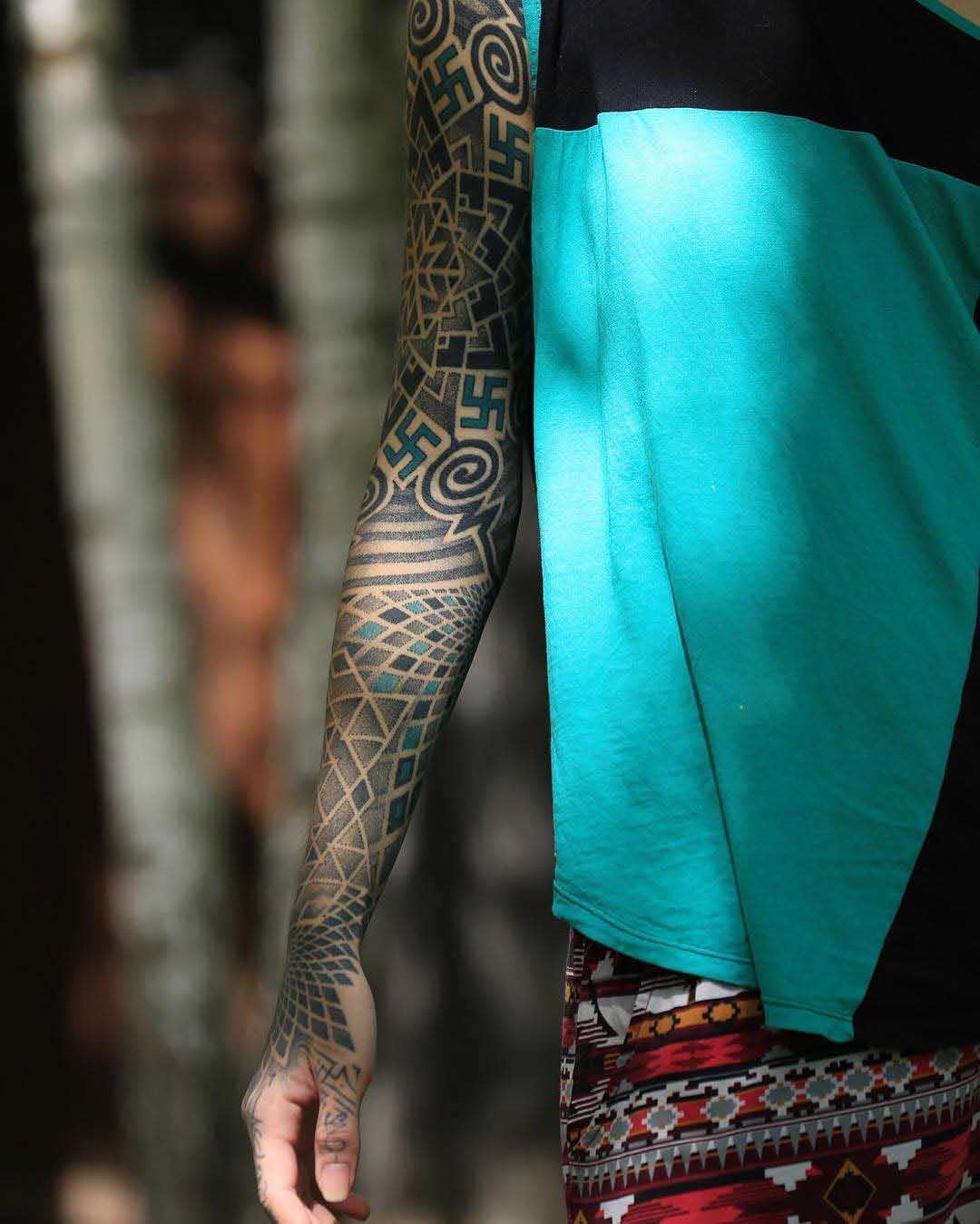 dotwork sleeve tattoo with swastikas