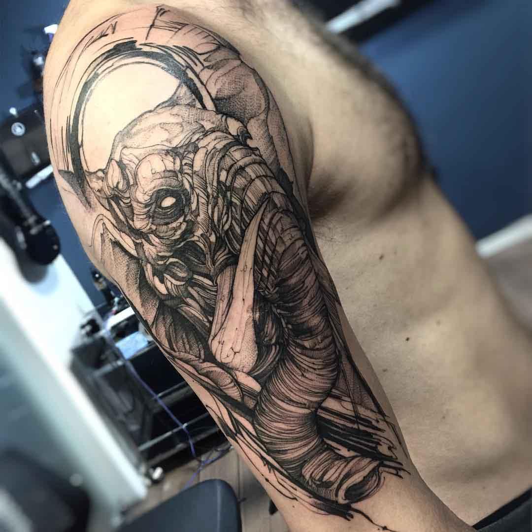 elephant tattoo on shoulder