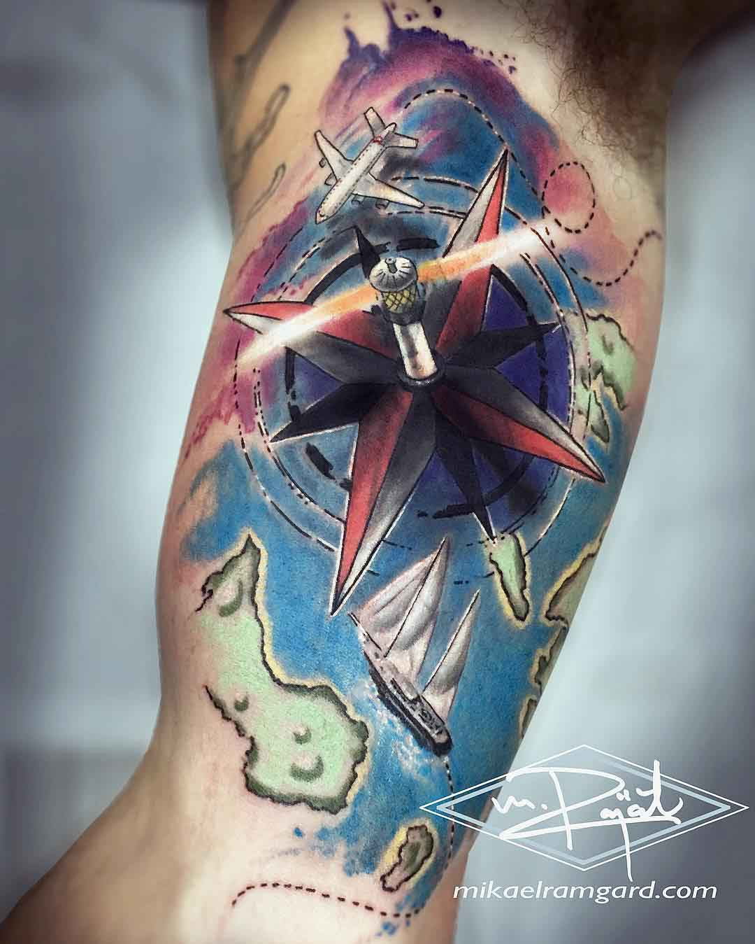 nautical tattoo on bicep travelling themed