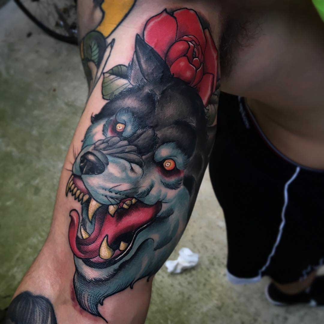 wolf tattoo on bicep
