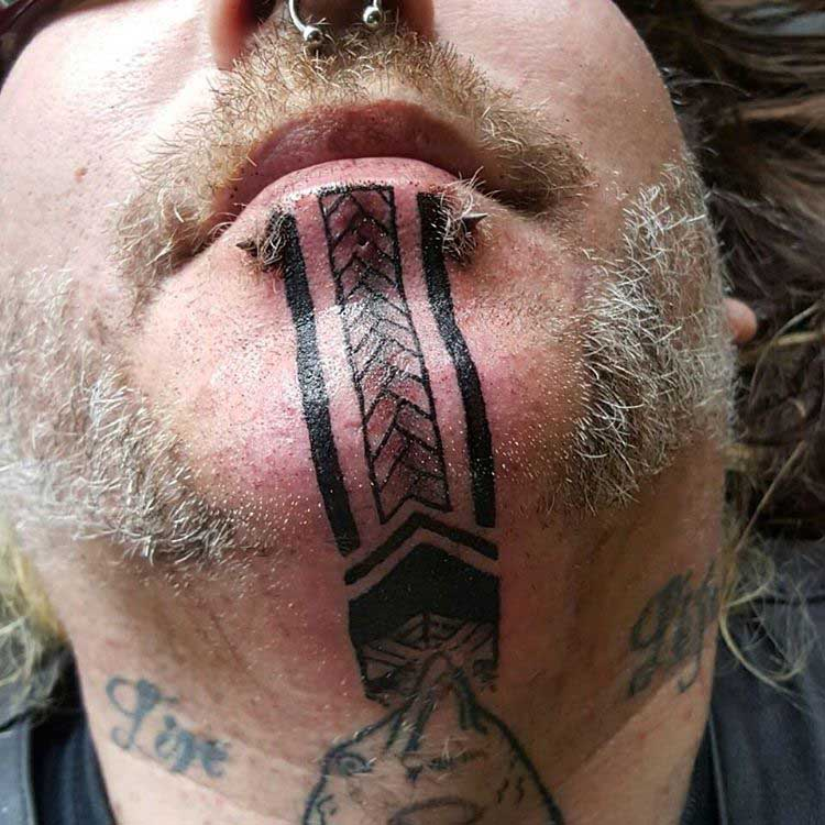Tattoos on Chin by thearthouseinc