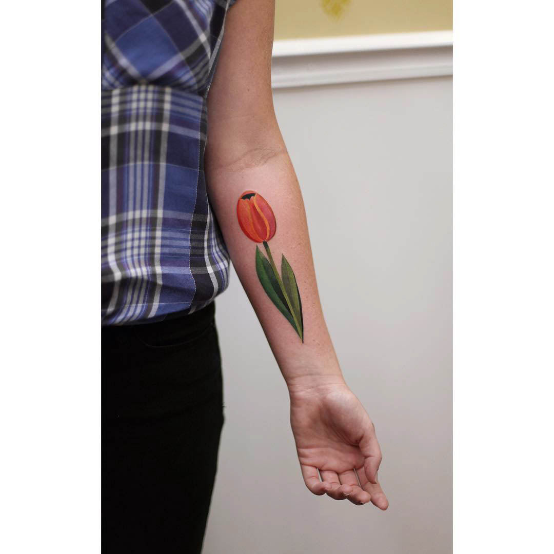 forearm tattoo of a tulip