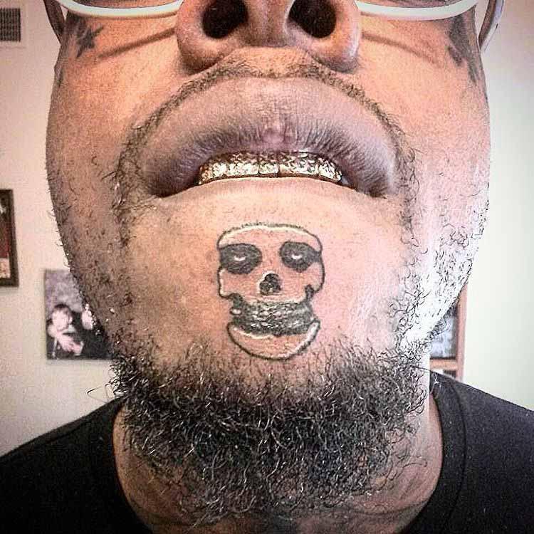 Weird Skull Tattoo on Chin by inksmith909