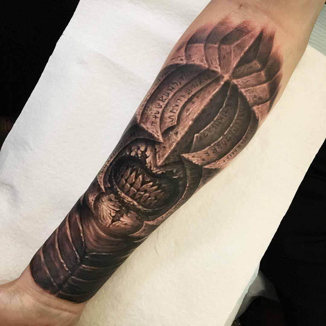 Sauron tattoo on forearm