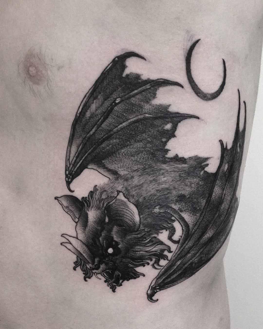bat tattoo on ribs